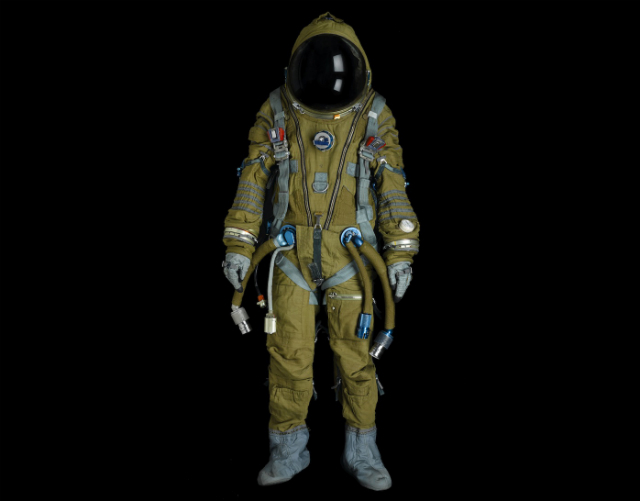 SOVIET FULL PRESSURE STRIZH RESCUE SPACESUIT.  Full pressure spacesuit, manufactured by NPP Zvedza, ca. 1988.  Olive flame-retardant nylon canvas with light blue and silver trim, inner pressure bladder of Kapron and resin, approximately 65 inches tall.  Est. $15,000-20,000