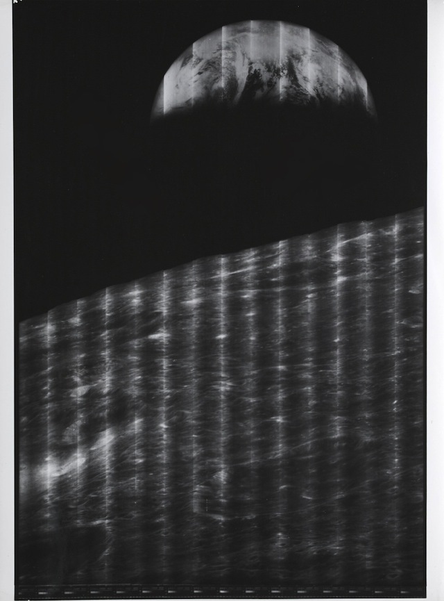 LUNAR ORBITER I.  THE FIRST IMAGE OF THE EARTH AS SEEN FROM THE MOON.  Silver gelatin print, 13½ by 10½ inches, on Kodak paper. August 23, 1966.  Est. $1,000-2,000
