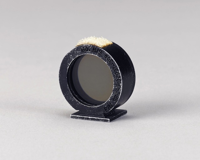 MOTION PICTURE RING SIGHT USED ON THE MOON DURING APOLLO 15.  Flown Maurer DAC (Data Acquisition Camera) sighting ring. Circular metal ring, 1¼ inches in diameter with an optical component at the center.   Est. $20,000-30,000