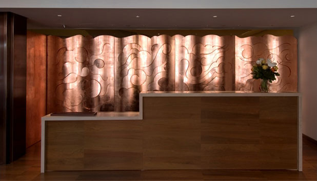 Glaser's copper cloud wall inside the Rubin Museum of Art (via miltonglaser.com)